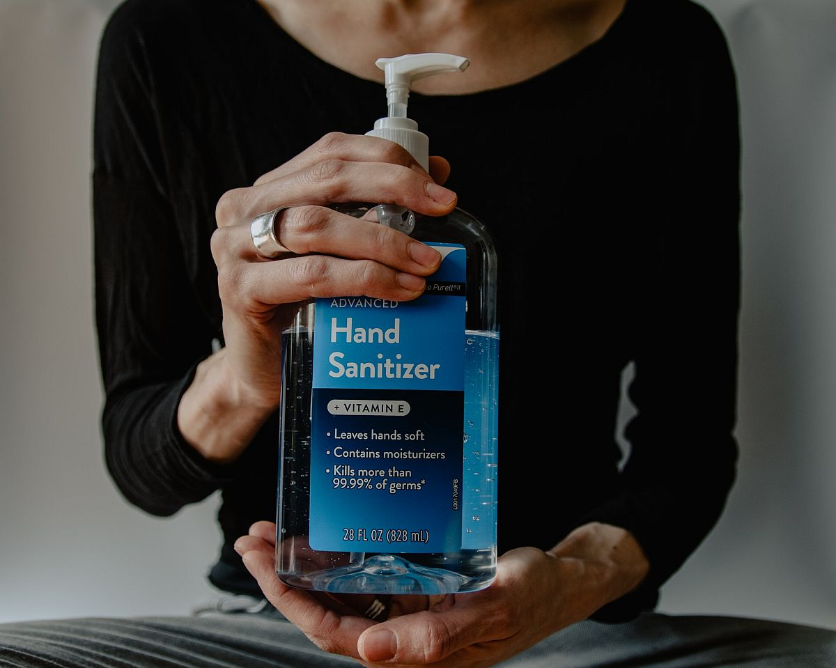 bottle of hand sanitizer; pandemic policies concept