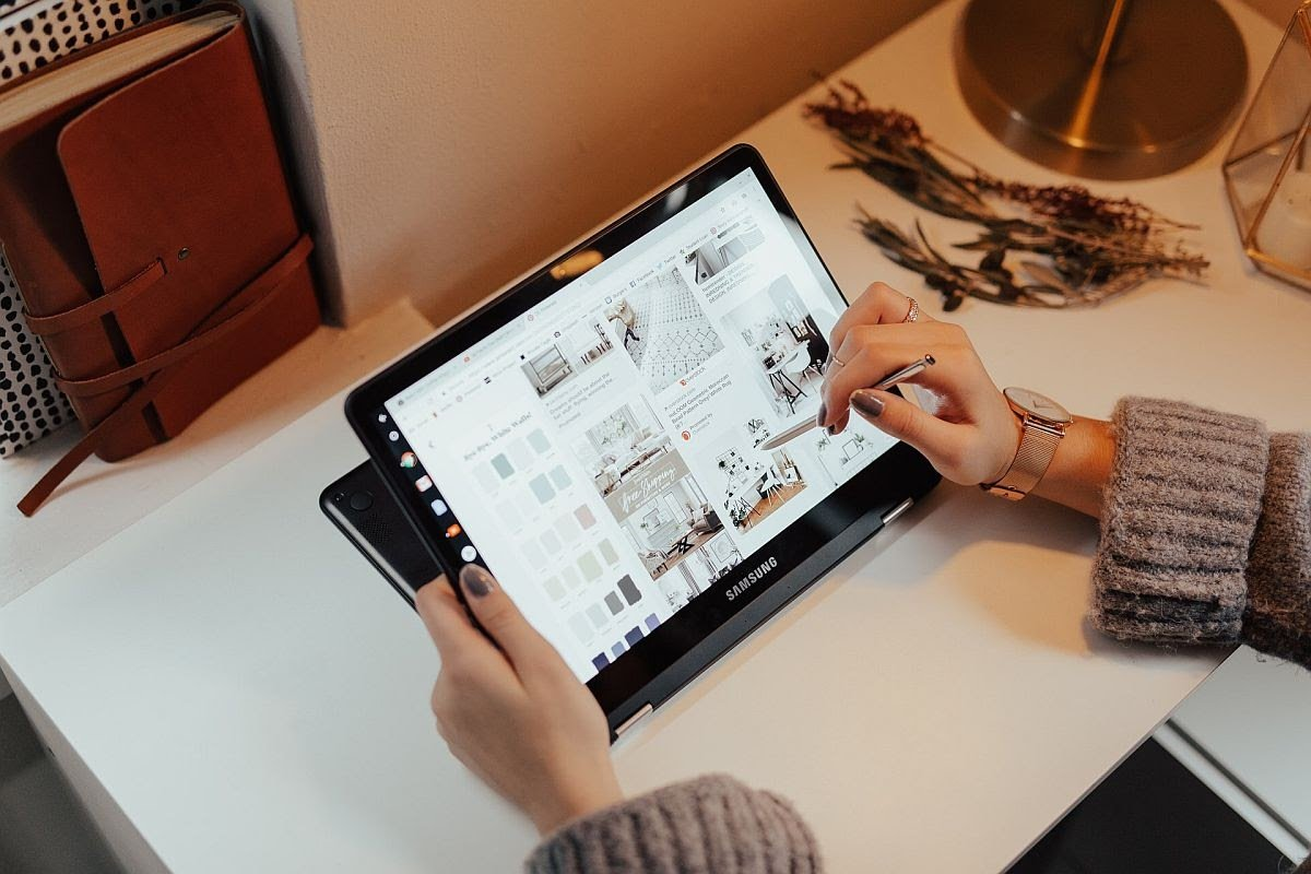 woman using a tablet to navigate a site to purchase interior design wares; first-time shoppers concept