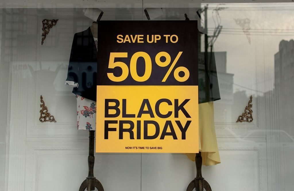 """Storefront window display sign reading """"Save up 50%""""; running a winning sales event concept"""