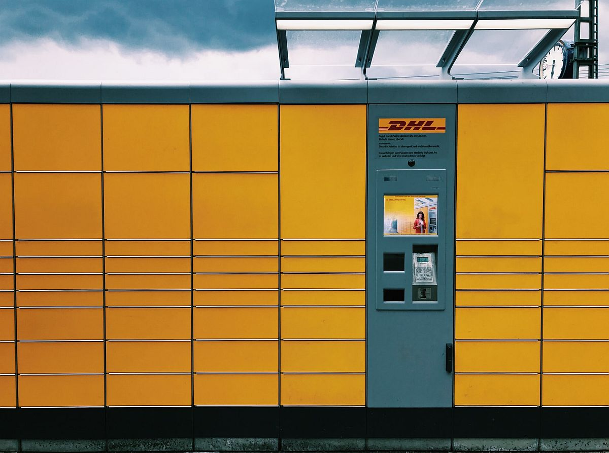 a row of DHL pickup lockers; improving DTC fulfillment concept
