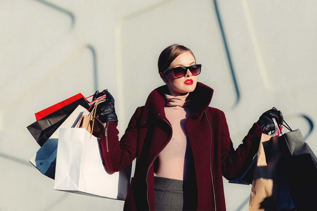 woman overloaded with many shopping bags; event sales and marketing concept
