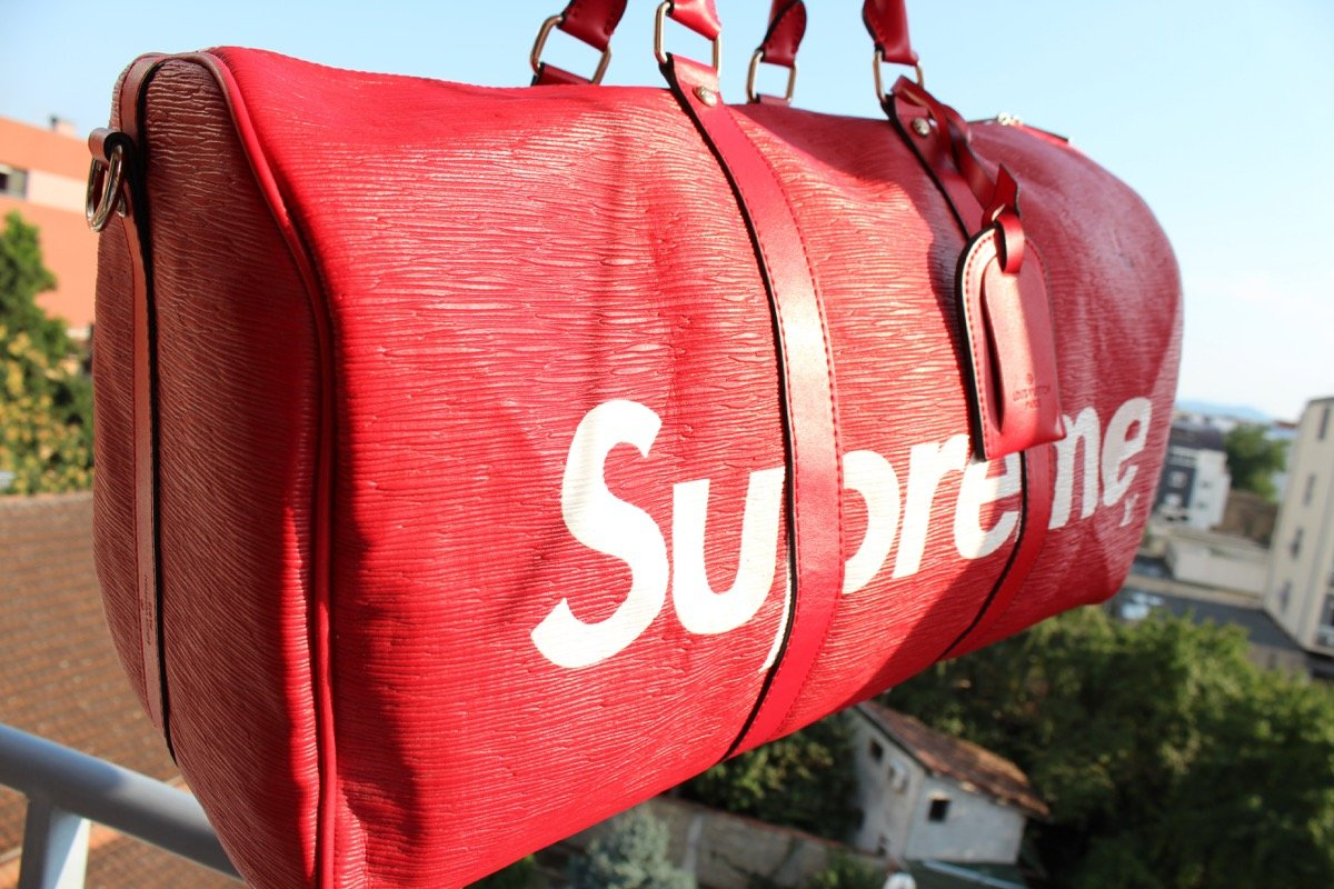 """Red """"Supreme"""" gym bag; clothing brand deploying product drops concept"""