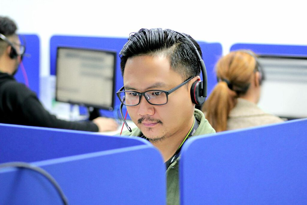 telephone support operator in headset; launching eCommerce fast concept