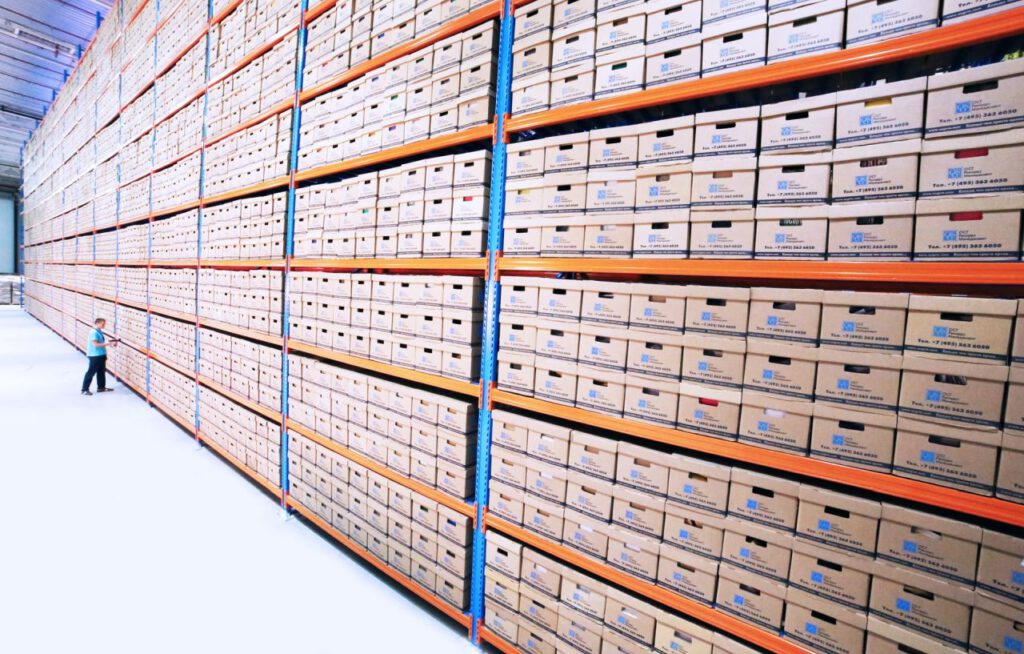 rows of boxes in a warehouse; launching eCommerce fast concept